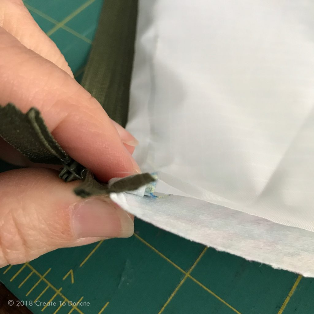 Pressing layers of fabric together for a simple toiletry bag