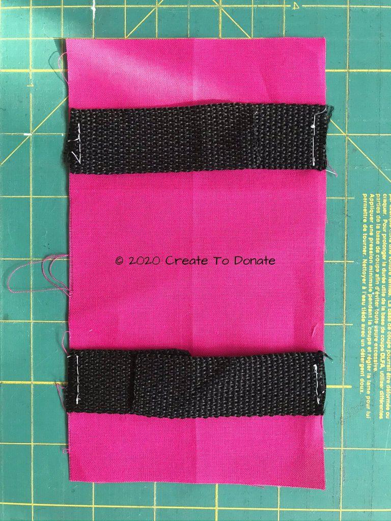 Baste webbing to port pillow fabric