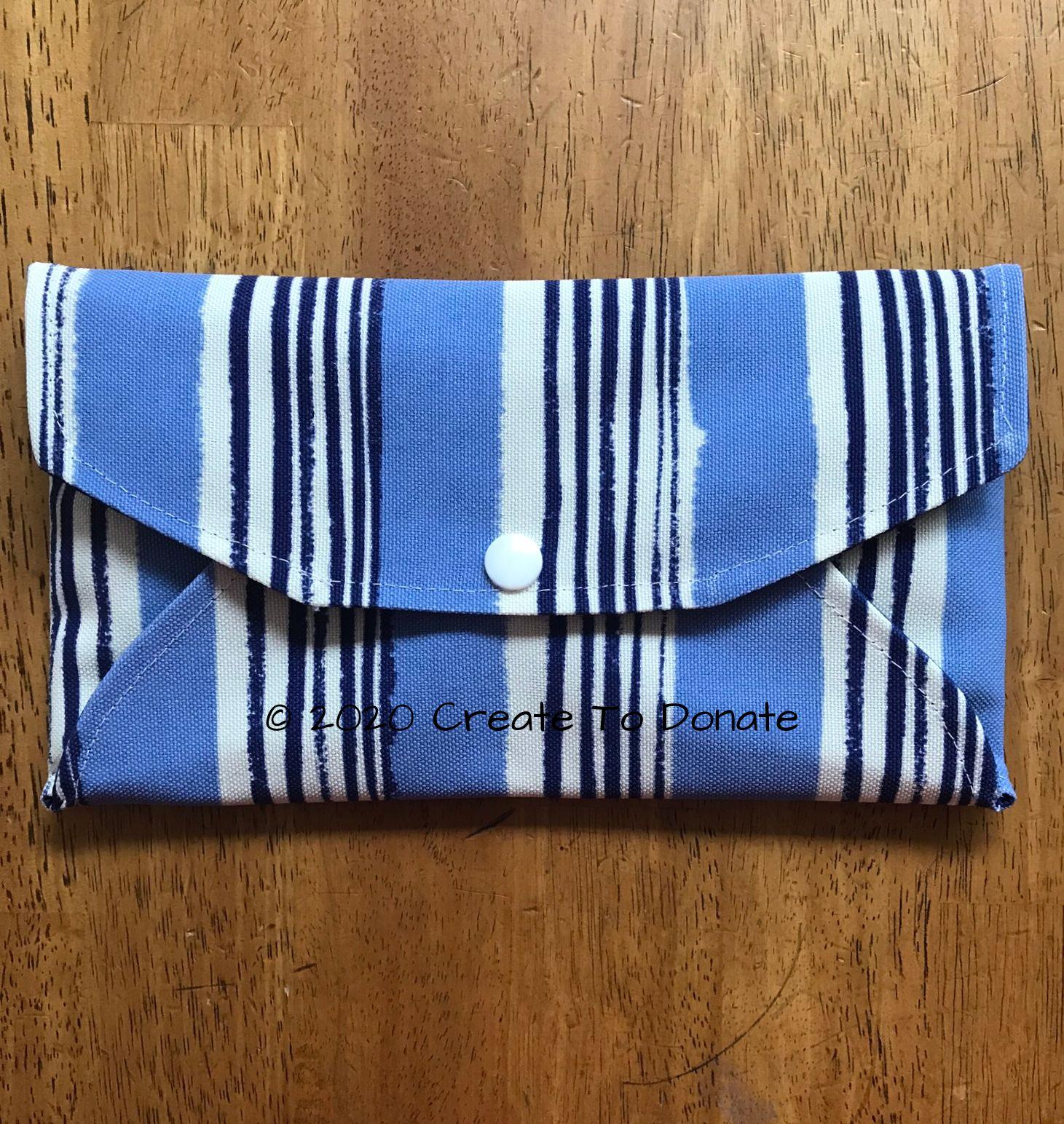 Make an envelope wallet for face mask storage