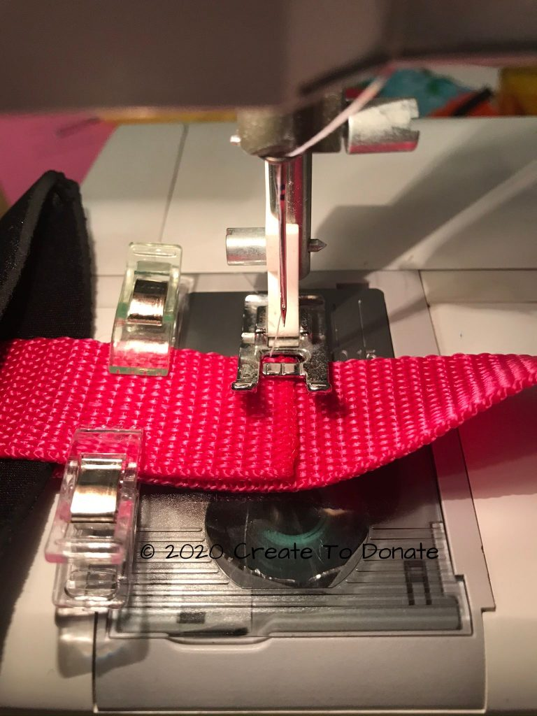 Sew the webbing together for the first mastectomy drain holder