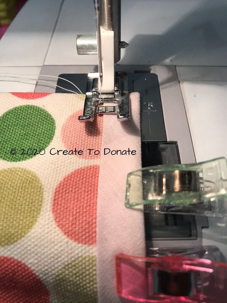 Sew bias tape to carry pouch fabric