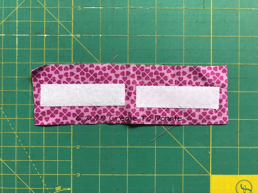 Both pieces of tape sewn to fabric