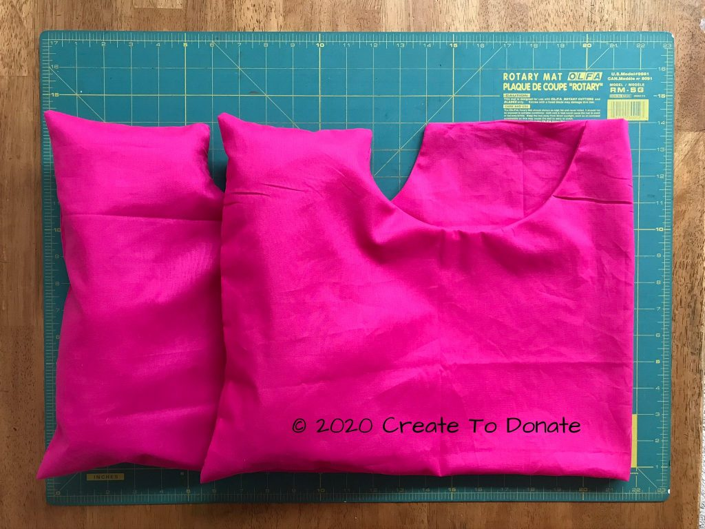 Unfilled double mastectomy pillow in pink made from the free pillow pattern offered by Create To Donate.