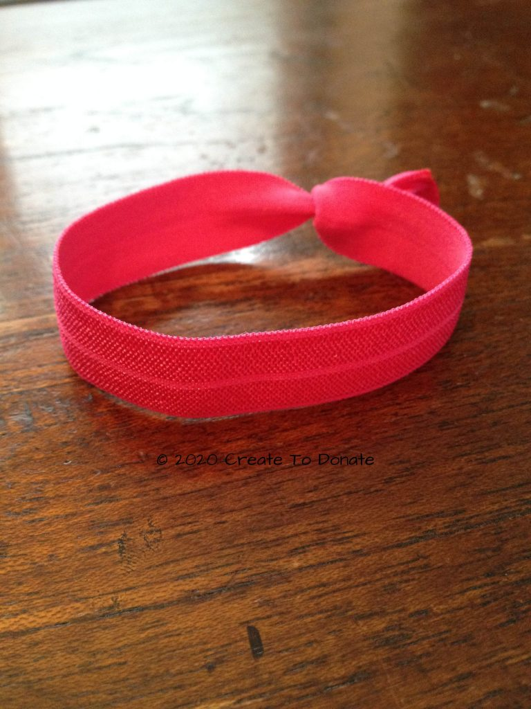 Finished hair tie using fold over elastic