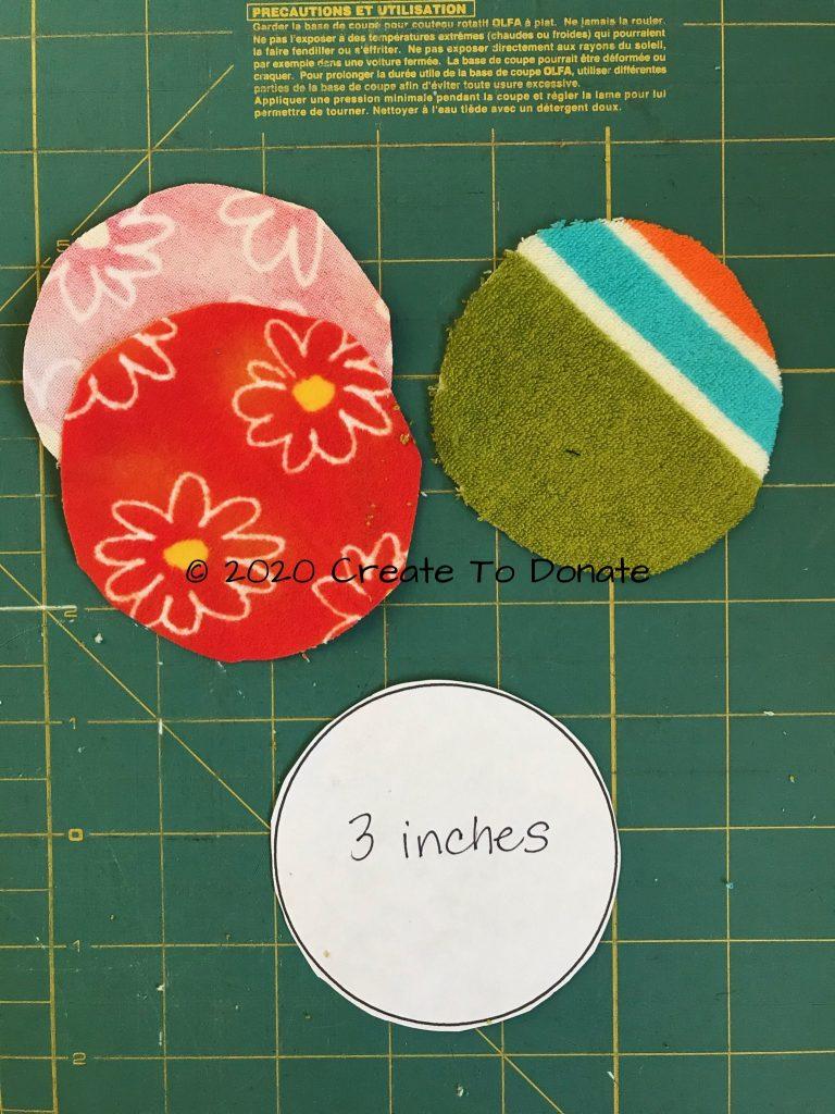 Cut three fabric circles for g-tube button cover