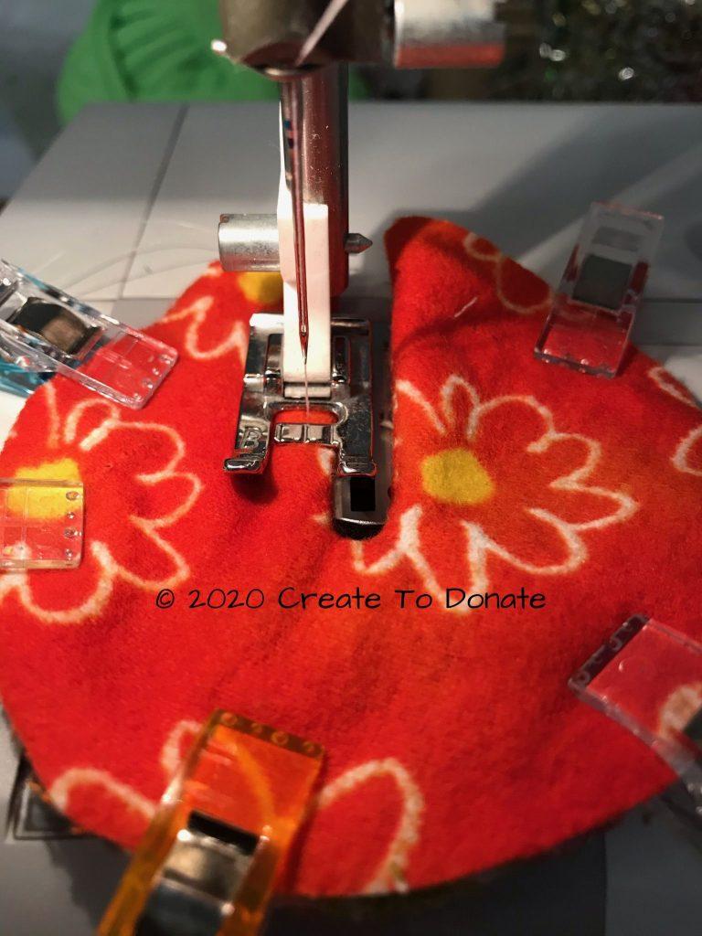 Top stitch inside seam g-tube cover