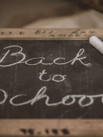 Chalkboard with words back to school written on it.