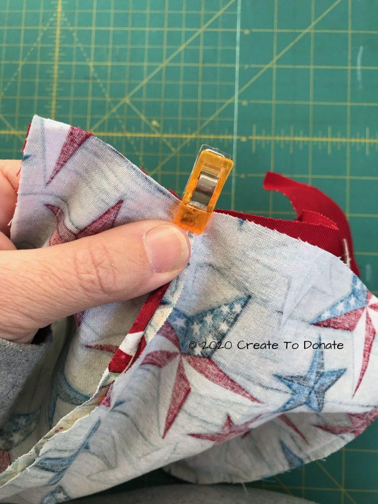 Clip back edge of scrub cap