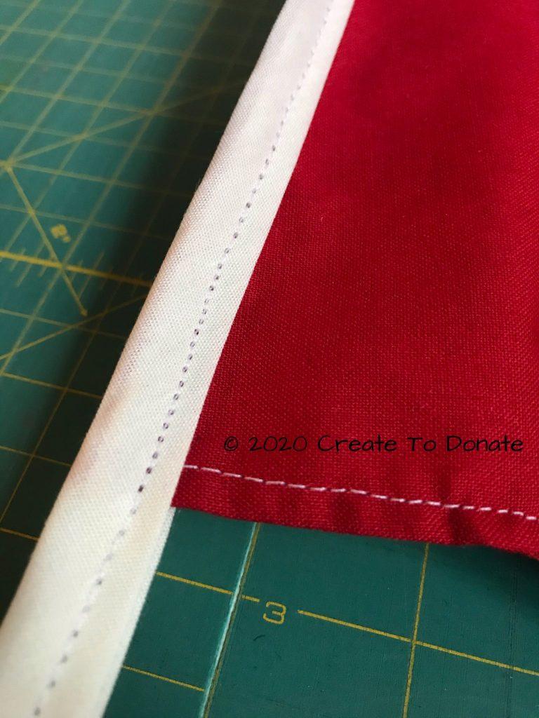 Binding sewn to scrub cap