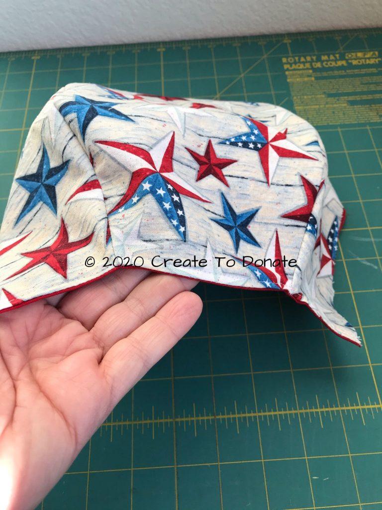Top stitch back edge scrub hat