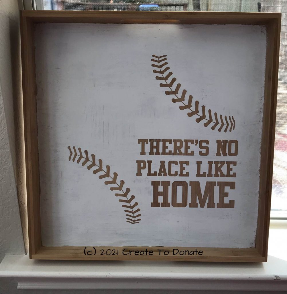 Wood serving tray that has customized baseball saying on it.