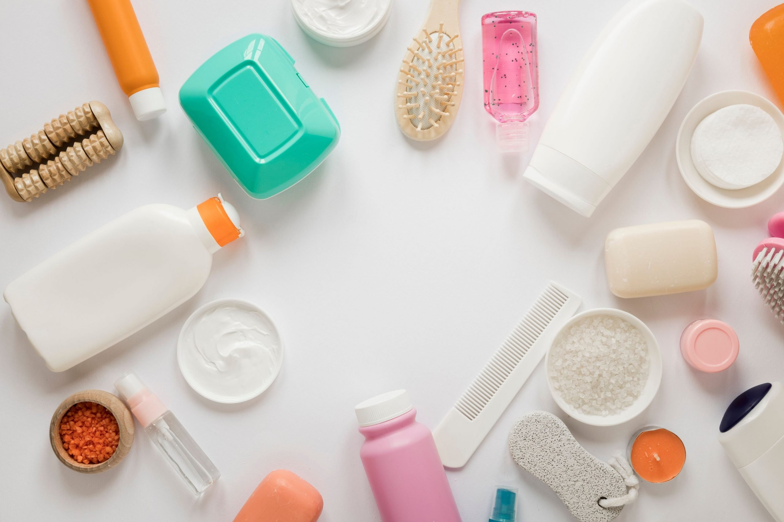 Top view of a variety of bath products to demonstrate things you put in a toiletry bag.