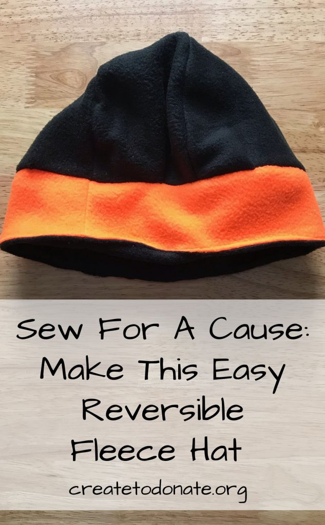 Black and orange reversible fleece hat made with free pattern.