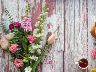 Flower bouquet on a wood plank to celebrate Mother's Day Giveaway 2021.