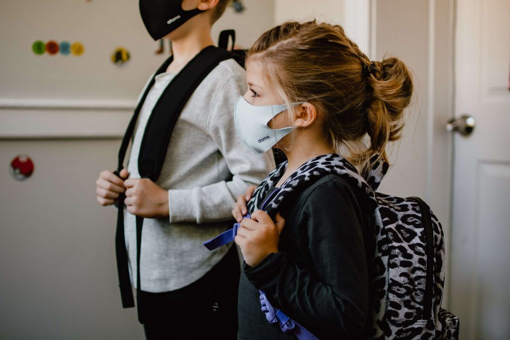 Children at school with masks on their faces.