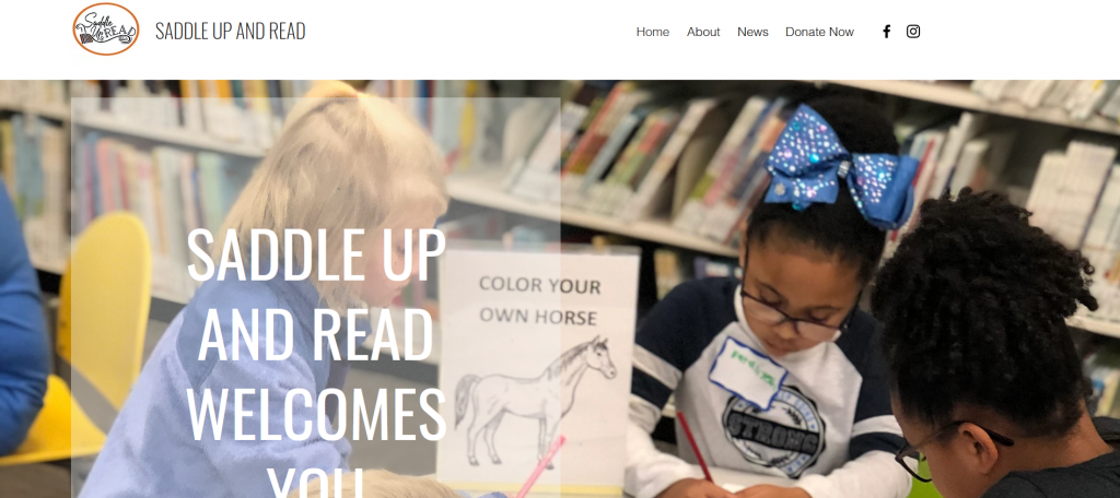 Screen grab from Saddle Up and Read's webpage that features a woman coloring with two children.